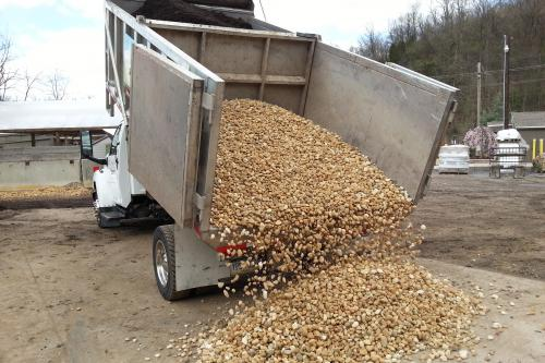 Dump Truck Delivering Mulch