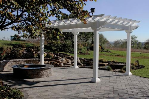 Artisan Vinyl 6x6 posts Pergola beside a fire pit