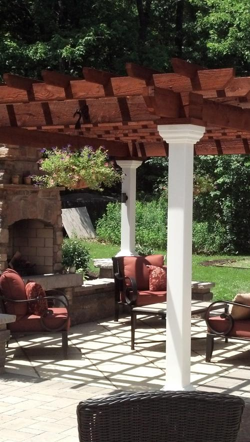 Pergola with furniture and a fireplace