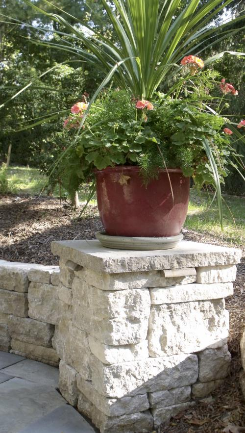 Flower pot on top of natural stone pillar